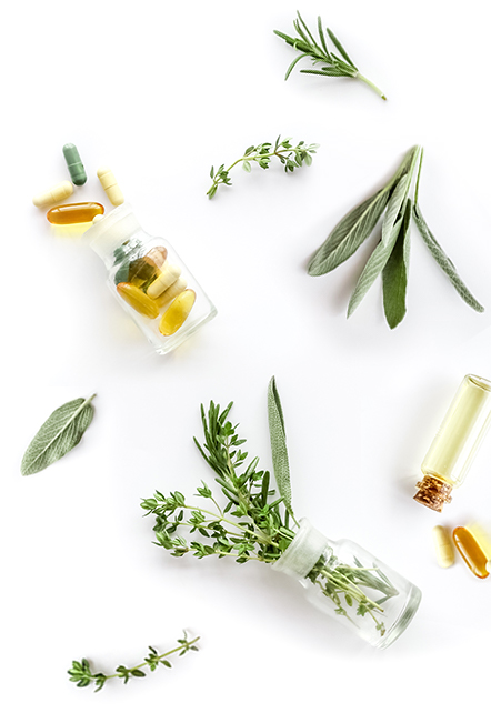 herbs and pills representing alternative and conventional medicine